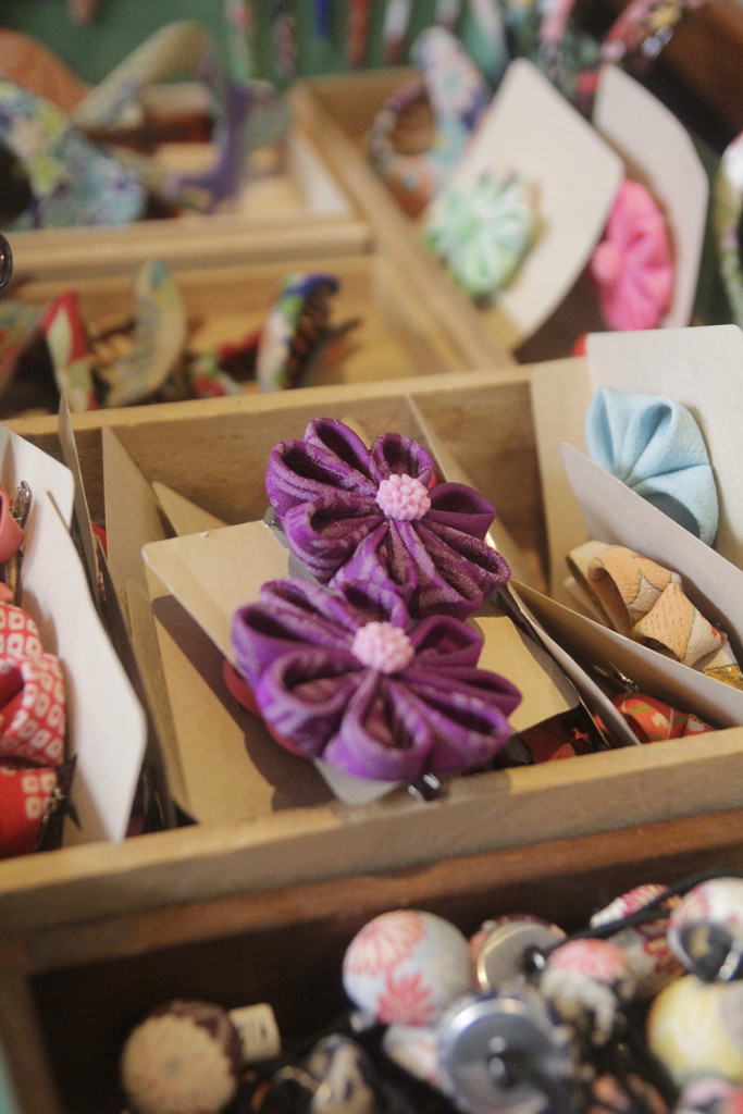 Precisely folded flowers made of vintage kimono fabric by Thea Starr